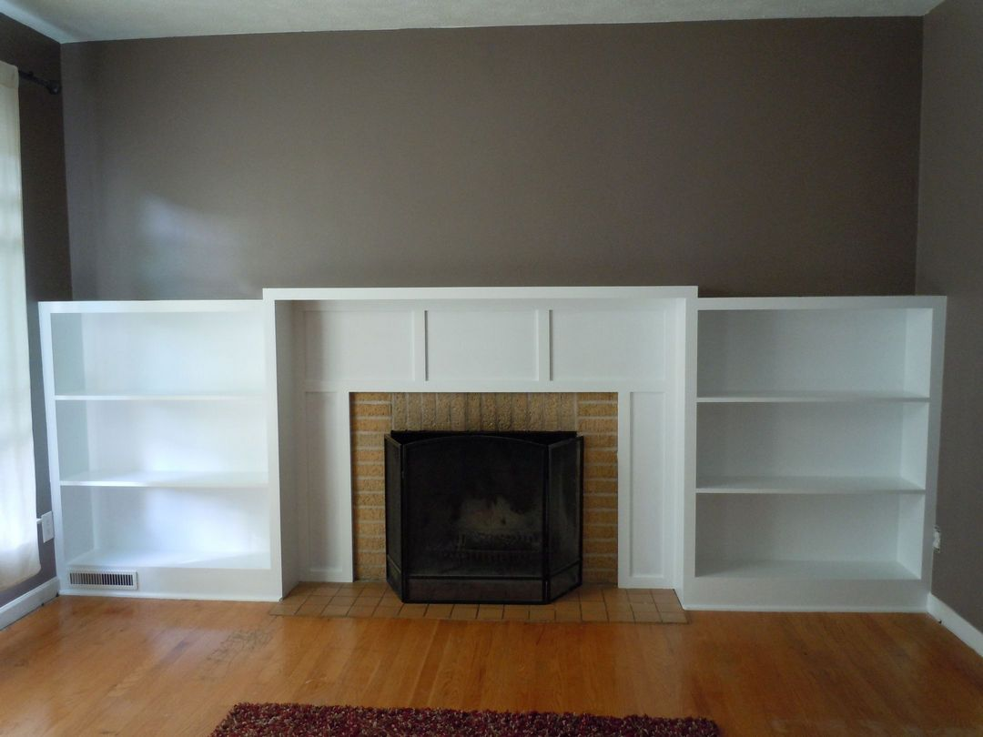 Built-in bookcases and mantel.