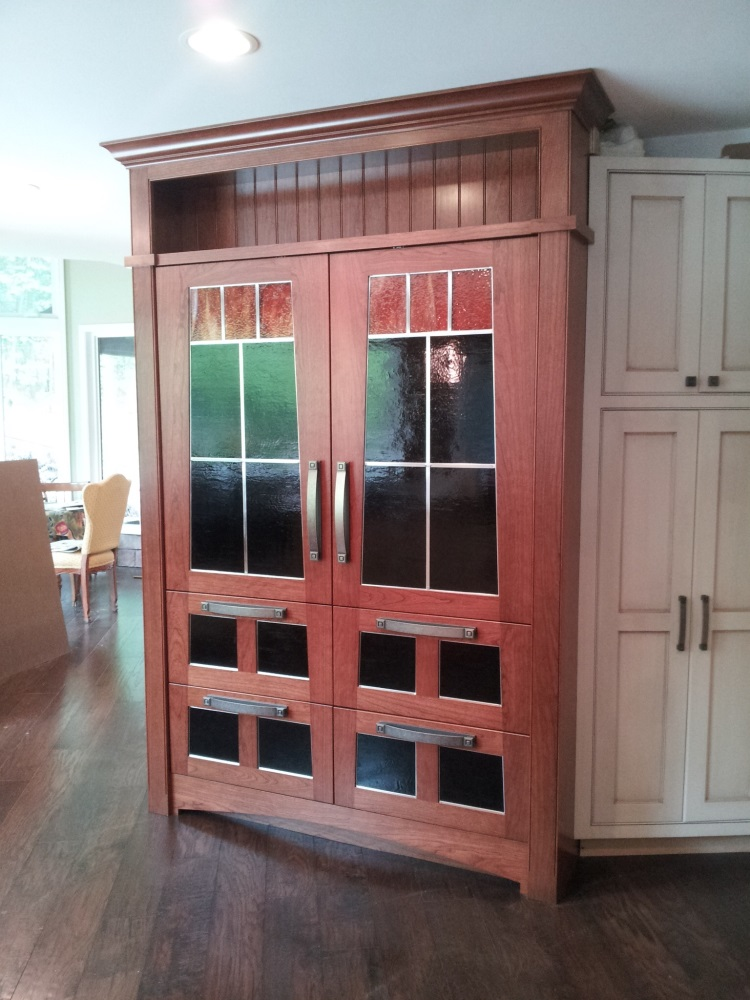 Custom panels for side-by-side refrigerators. Stained glass done by local artisan.