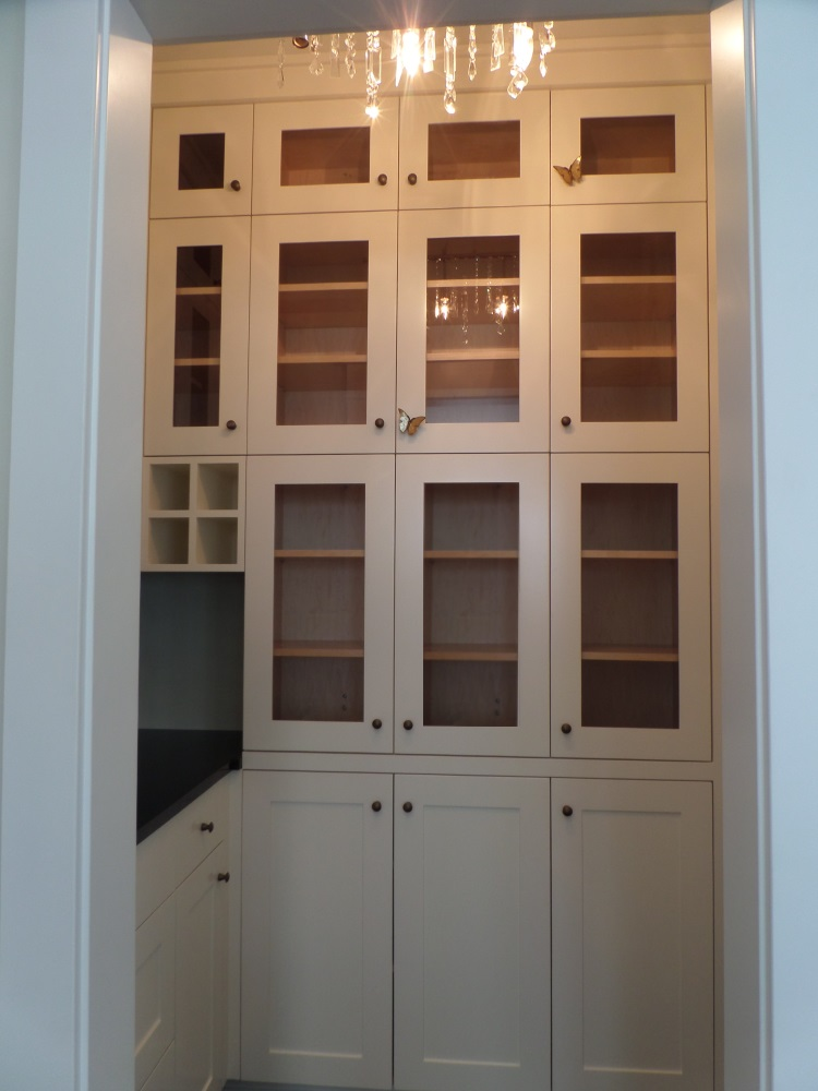 Walk-in pantry for large custom kitchen.