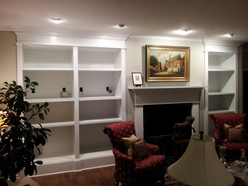 Built-in shelves, mantel, and trim work for home remodel.