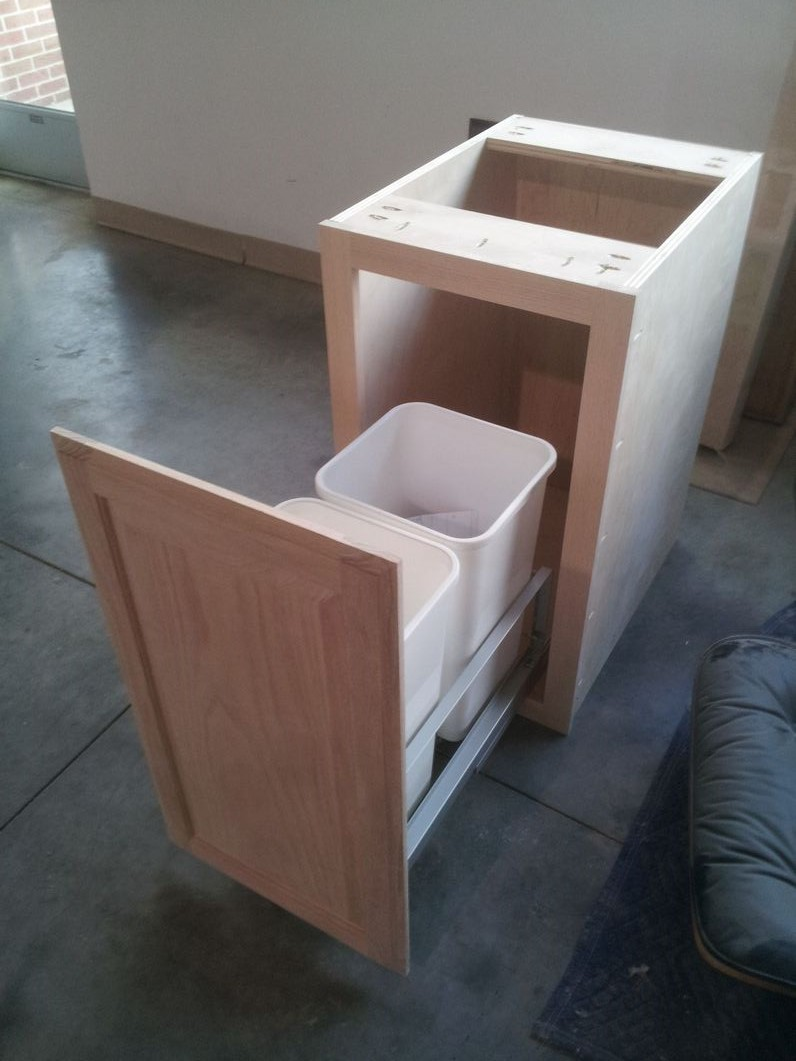 Trash pull-out cabinet.