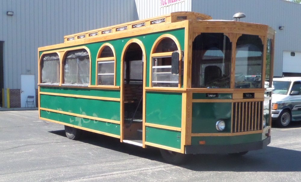 Trolley restoration, with steam bent wood trim and curved window moulding.