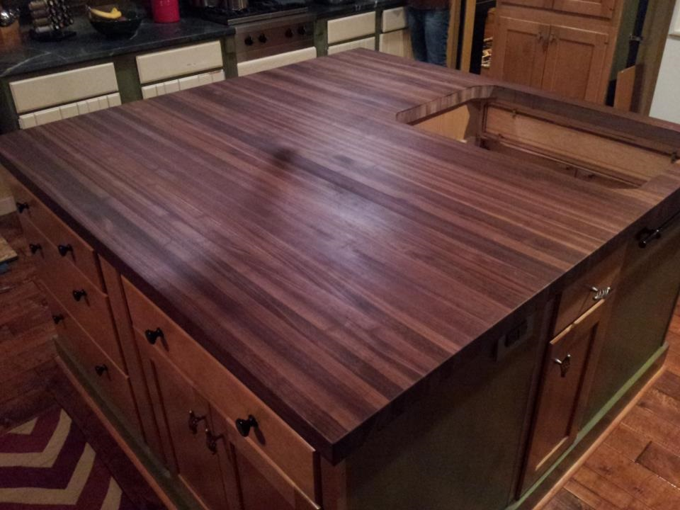 Large walnut butcher block surface for existing kitchen island.